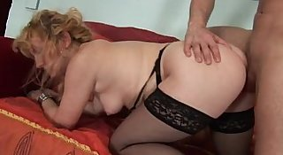 His hot and naughty mom teaches him how to fuck