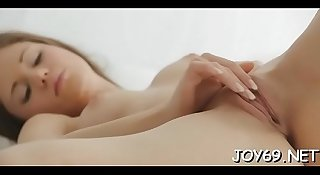 Solo girl inserts toy in cunt